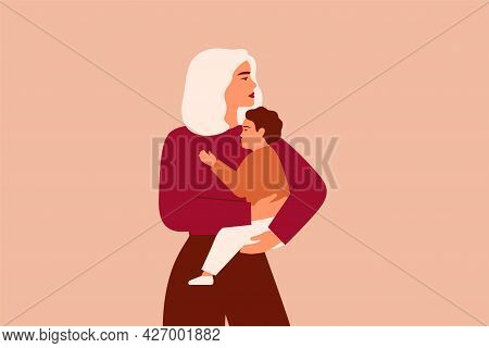 Caucasian Woman Holds Her Baby Boy With Love And Care. Strong Working Mother Cuddles Her Child And L