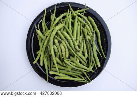 Top View Of Radish Pods Heap Isolated On White Background. Fresh Organic Indian And Pakistani Vegeta