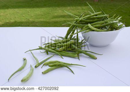 Radish Pods Heap Isolated On White Background. Fresh Organic Indian And Pakistani Vegetable Selectiv