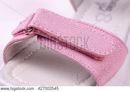 Macro With Girls Pink Sandal. Summer Casual Footwear On The White Isolated Background