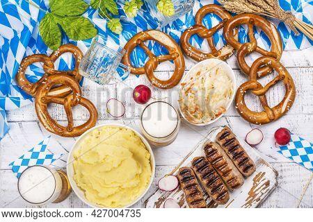 Oktoberfest Background. Food For Oktoberfest Party - Bavarian Grilled Sausages, Pretzels, Mashed Pot