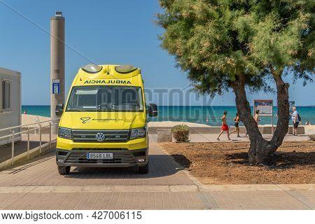 Platja De Palma, Spain; July 16 2021: Yellow Ambulance Parked On The Promenade Of The Beach Of Palma
