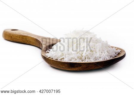 Wooden Spoon Rustic With Grated Coconut On White Background With Copy Space, Culinary Ingredient