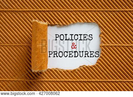 Policies And Procedures Symbol. Words 'policies And Procedures' Appearing Behind Torn Brown Paper. B