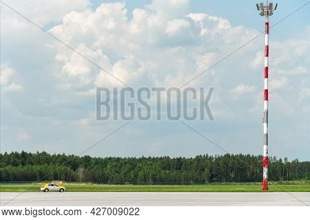 Old Red And White Airport Runway Lighting Tower