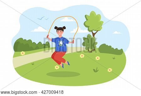Jumping Rope Concept. A Little Girl Is Playing In The Park With A Rope. The Child Is Engaged In Spor