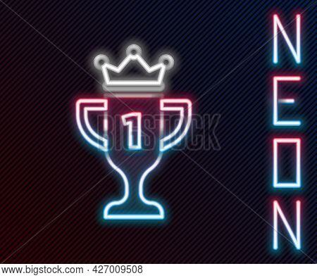 Glowing Neon Line Award Cup Icon Isolated On Black Background. Winner Trophy Symbol. Championship Or