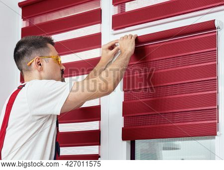 Mounting Shutters, Man Installing Fabric Blinds. Handyman Installing A Part Of Roller Window Blind I