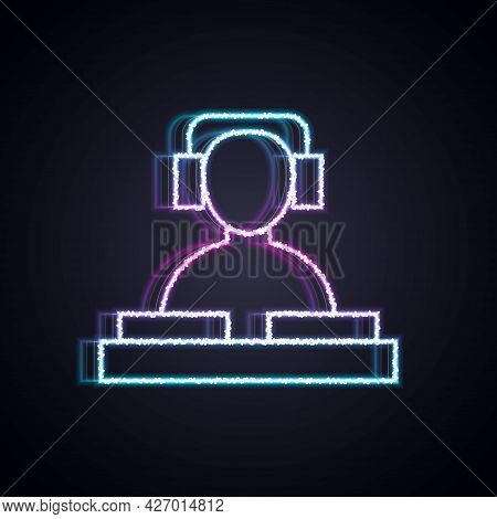 Glowing Neon Line Dj Wearing Headphones In Front Of Record Decks Icon Isolated On Black Background.