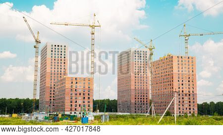 View Of The Construction Of New High-rise Buildings With Tower Cranes On A Clear Sunny Day, Construc
