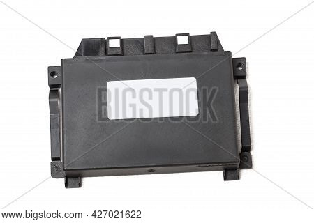 Plastic Car Engine Control Unit With Metal Elements On A White Isolated Background Is The Connecting