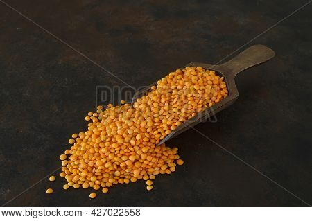 Heap Of Red Lentil With Wooden Spoon. Healthy Eating Containing Natural Vitamins And Minerals. Pile