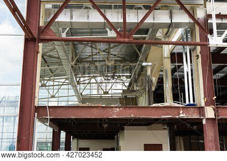 Demolition Work Or Demolition . Wrecking Of A Modern Commercial Building. Destruction Concept.