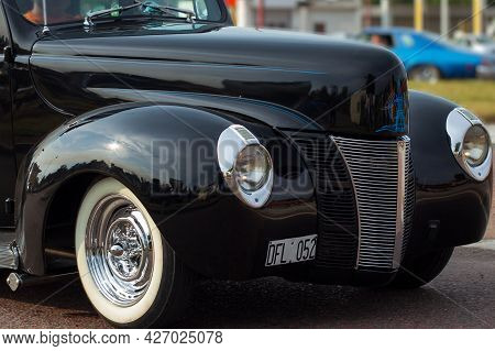 Closeup Of The Front Of An Antique Car.
