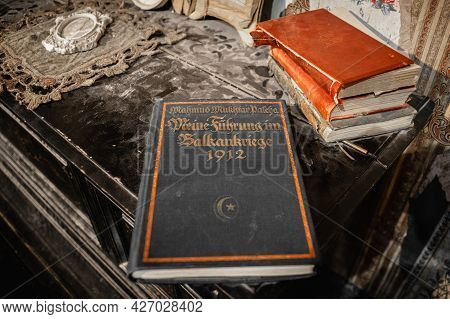 Moscow, Russia - April 10, 2019: Ancient Books On Top Of The Dusty Cupboard.