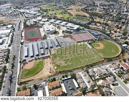 Aerial View Of San Marcos Neighborhood With School And Sport Field, San Diego, California, Usa. July