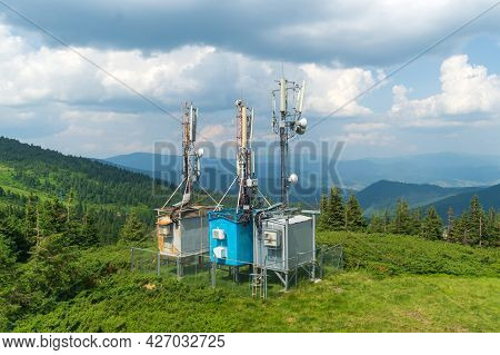 Three Telecommunication Towers With 5g Cellular Network Antennas On Nature Background, Big Digital D