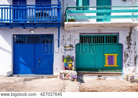 Colorful Blue And Green Garage Doors In Greek Klima Fishermen Village - The Most Colorful Village In