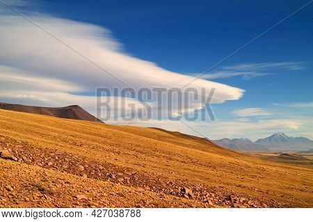 The Arid Foothill Of Los Flamencos National Reserve With The Amazing Lenticular Clouds In The Backdr