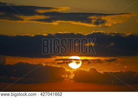 The Brightly Contrasting Cloudy Sky At Sunset