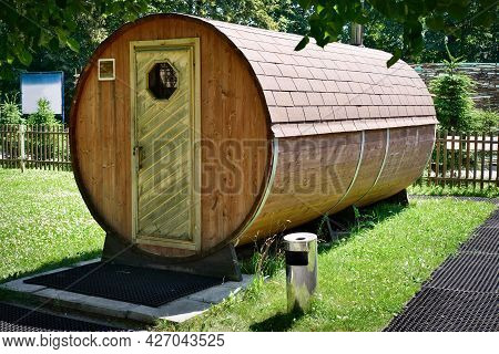 Mobile Compact Wooden Sauna Or Bath. Bathhouse Near The Lake In Summer.