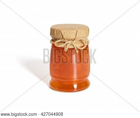 Jam In A Glass Jar Isolated On A White Background. Juicy Homemade Fruit Jam.