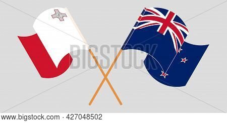 Crossed And Waving Flags Of Malta And New Zealand