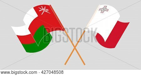 Crossed And Waving Flags Of Malta And Oman