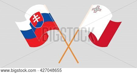 Crossed And Waving Flags Of Malta And Slovakia