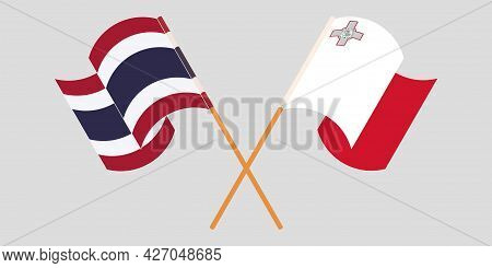 Crossed And Waving Flags Of Malta And Thailand