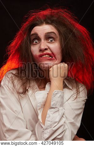Fun Crazy Young Woman With Fluffy Hair On Black Background Make Grimace