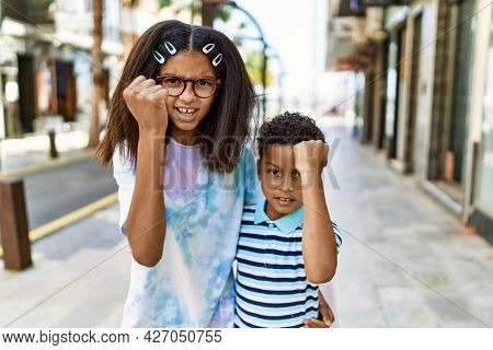 African american family of bother and sister standing at the street annoyed and frustrated shouting with anger, yelling crazy with anger and hand raised