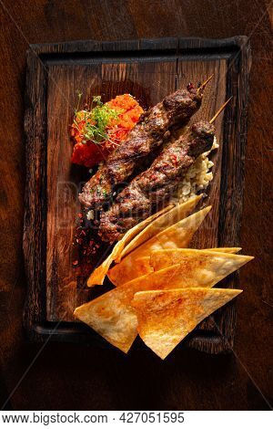 Barbecued kofta - kebeb with vegetables on a plate