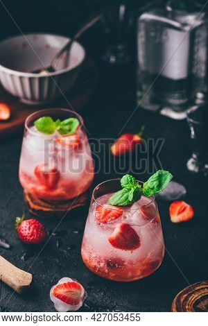 Cocktail With Fresh And Frozen Strawberries, Gin And Tonic In Two Glasses
