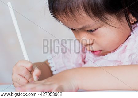 Close Up Asian Girl Learning Homeschool. Education Of Kindergarten Child Concept. Kid Aged 4-5 Years