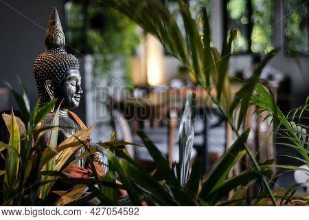 Buddha Statue In Interior Garden At Modern Tropical Bar In Bangkok Thailand