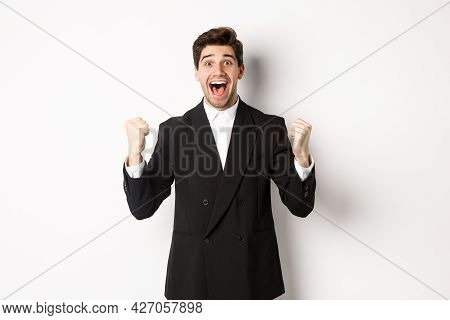 Image Of Happy And Relieved Businessman Feeling Lucky, Making Fist Pumps And Smiling With Joy, Achie