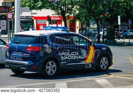 Seville Spain July 10, 2021 Police Car Patrolling In The Streets Of Seville, An Emblematic City And