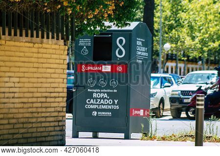 Seville Spain July 10, 2021 Garbage Container In The Streets Of Seville, An Emblematic City And The