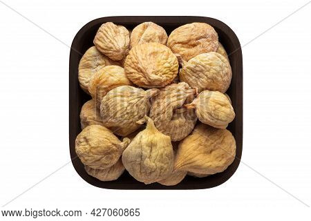 Dried Figs In Wooden Bowl Closeup. Dried Figs Isolated On White.