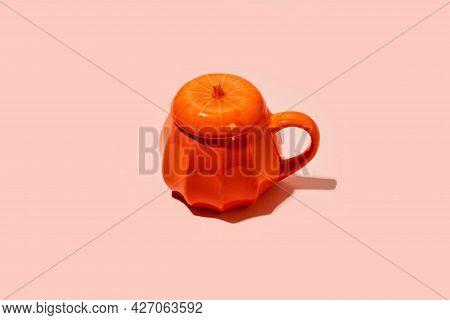 Ceramic Coffee Tea Soup Cup As Pumpkin On Pink. Halloween Concept, Hard Shadow, Minimal