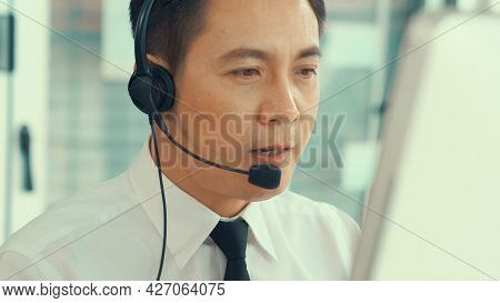 Businessman Wearing Headset Working Actively In Office . Call Center, Telemarketing, Customer Suppor