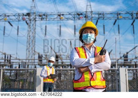 Female Electrical Engineers Working At Power Substations, Electrician With Radio Communication In Ac