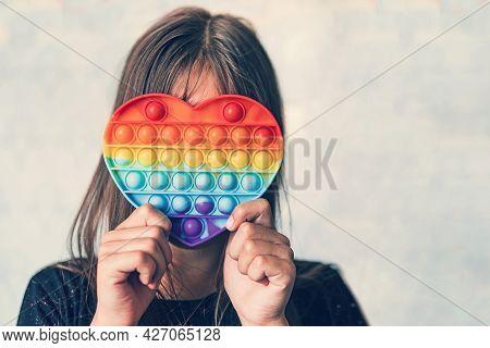 Cute Faceless Child Playing With The Pop It Fidget. Push Pop Bubble Flexible Fidget Sensory Toy Prov