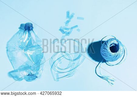The Concept Recycling Plastic. Empty Plastic Bottle Recycled Polyester Fiber Recycled Products Again