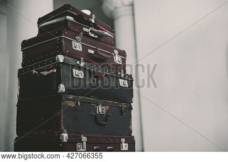 Stack Of Vintage Suitcases . Background With Large Stack Of Antique Suitcases