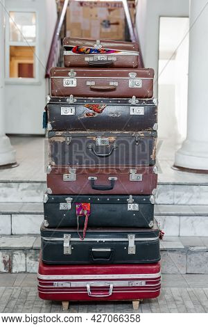 Stack Of Vintage Suitcases . Close Up . Background With Large Stack Of Antique Suitcases