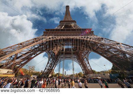 Eiffel Tower in clouds, Paris.