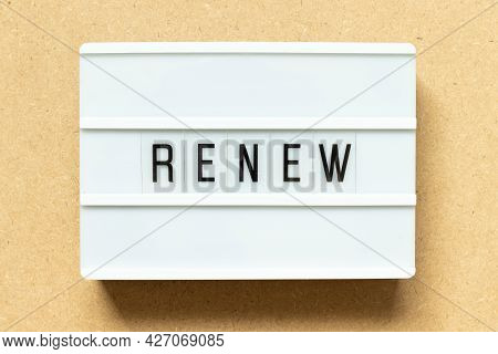 Lightbox With Word Renew On Wood Background