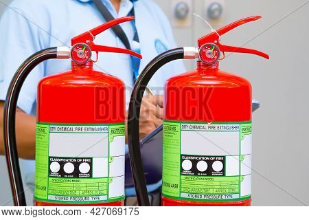 Fire Extinguisher, Close-up Red Fire Extinguishers Tank With Engineer Checking Pressure Gauge Level